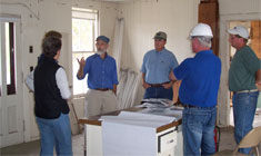 Bill Badger AIA holding a meeting at the West River Railroad Depot Jobsite